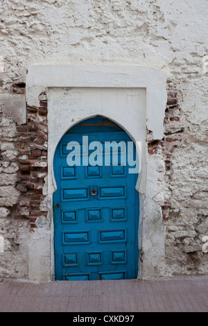 Part of an old house with a wooden, blue door, Essaouira, Morocco - Stock Photo