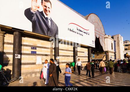 Bashar al-Assad billboard poster by Al Hamadiyya Souq entrance. Damascus, Syria - Stock Photo