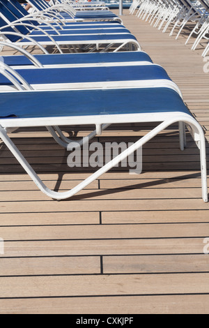 lounge  chairs on a cruise ship deck - Stock Photo
