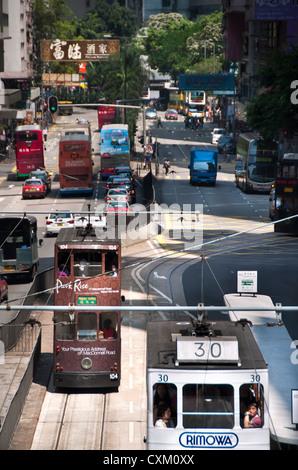 Hong Kong trams, Hennessey Road, Wanchai - Stock Photo