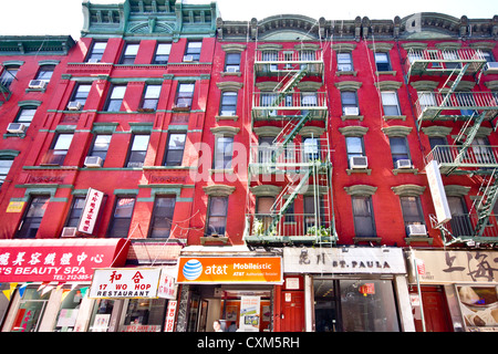 New York City - Aug 29:  Historic tenement apartment buildings and businesses in New York City Chinatown on August - Stock Photo