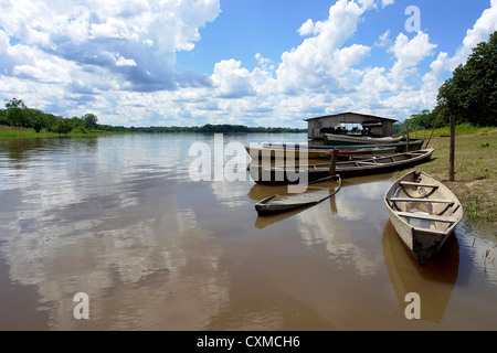 Amazon river native community boat pear - Stock Photo