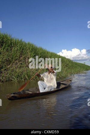 Amazon fisherman in river margin - Stock Photo