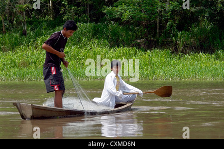 Amazon river young fisherman's, the river is the main food resource to the native population - Stock Photo