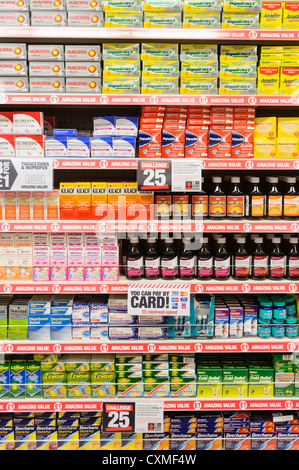 Selection of tablets and medicines on sale on the shelves in a Poundland shop store. - Stock Photo