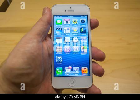 New York, NY, USA, Apple Store, Man's Hand Holding a New 'Iphone 5' Smart Phone, Manhattan - Stock Photo