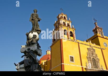 Basilica of Our Lady of Guanajuato with statue on fountain in Plaza de la Pax - Stock Photo