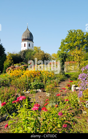 Abbey garden and church tower of Abtei Frauenwoerth Abbey, Benedictine Abbey, Frauenchiemsee or Fraueninsel, Women's - Stock Photo