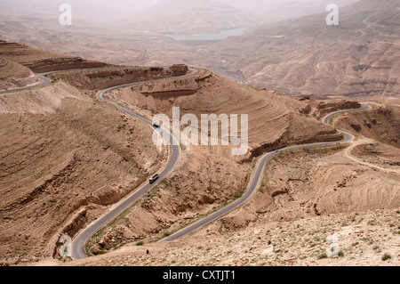 Wadi Al-Mujib Road with Al-Mujib Dam, Jordan - Stock Photo