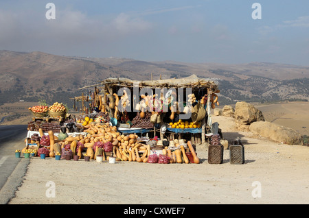 Squash and vegetable stall on the roadside with the Rif Mountains in the background in Morocco - Stock Photo