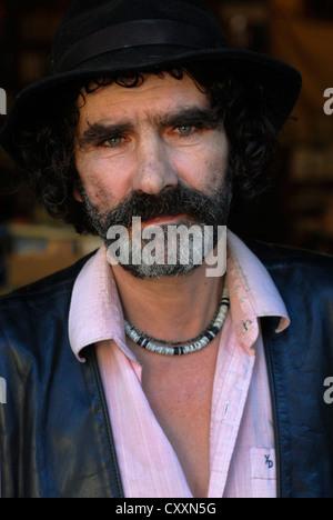 Man moustache, Hat, Librairie Par Chemins, Cours Julien Bookshop, Marseille, Provence Alpes Cote d Azur, France, - Stock Photo