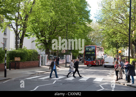 Abbey Road, tourists on the well-known zebra crossing made famous through the Beatles, London, England, United Kingdom, - Stock Photo