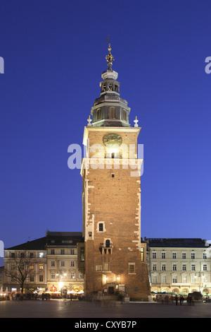 City hall tower in front of Sukiennice, Krakow Cloth or Drapers' Hall, main square, Rynek Glowny, dusk, Krakow, - Stock Photo