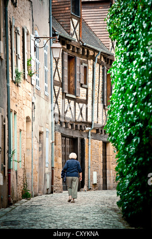 Street with old houses, in Montignac, Vézère Valley, Perigord, France, Europe - Stock Photo