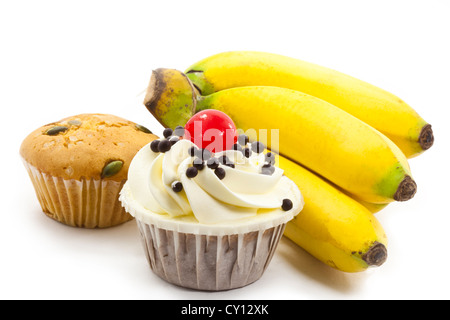 cup cake and bunch of bananas - Stock Photo