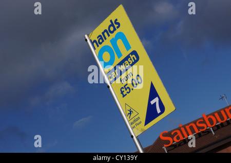 hands on carwash - imigrants washing cars in sainsburys car park - uk - Stock Photo