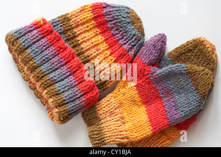 Brightly coloured knitted hat and mitts isolated on white background - Stock Photo