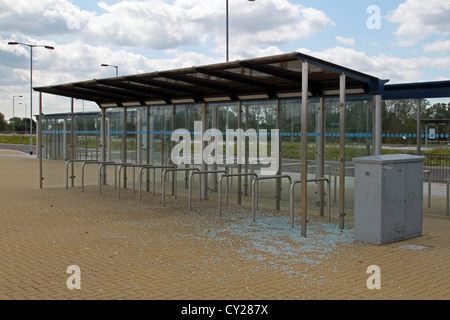 Vandalized bus stop on the guided bus way between Cambridge and St Ives - Stock Photo