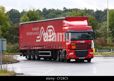 A Norbert Dentressangle truck traveling around a roundabout in England - Stock Photo