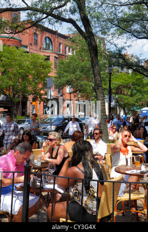 Boston Massachusetts Newbury Street high-end luxury name-brand shopping woman man Stephanie's On Newbury restaurant - Stock Photo
