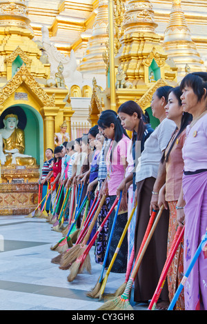 Women during the daily Sweeping of the Compound of the Shwedagon Pagoda in Rangoon, Myanmar - Stock Photo