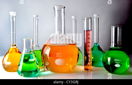 Glass lab flasks filled with colored liquids. - Stock Photo