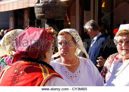 Men and women dressed in old traditional costumes at Dolac market,Zagreb,Croatia - Stock Photo