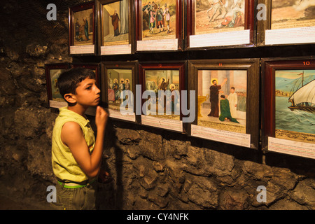 Arab Christian boy at the Chapel at the House of Ananias, an early Christian disciple. Damascus, Syria - Stock Photo
