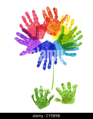 a flower made out of child's hand prints in rainbow colours on a white background - Stock Photo