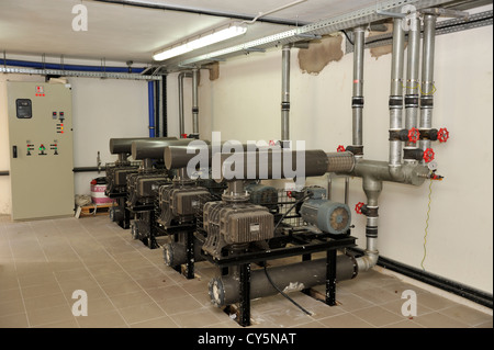Air compressors used in water treatment facility of a large resort hotel - Stock Photo
