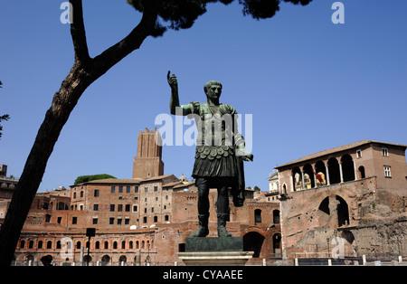 italy, rome, bronze statue of the emperor trajan and trajan's markets - Stock Photo