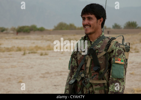 An Afghan National Army Soldier maintains security during an Afghan National Security Force led security patrol - Stock Photo