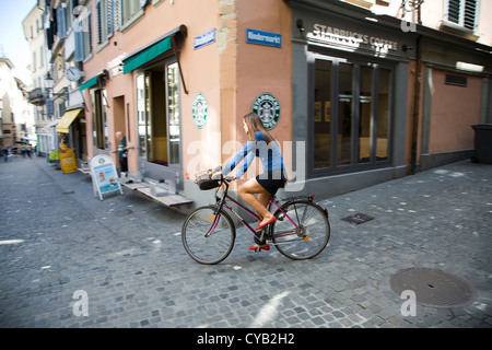 europe, switzerland, zurich, old town, girl by bicycle - Stock Photo