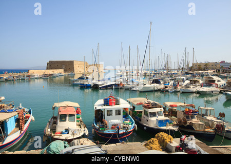Venetian Fortress and fishing boats at Heraklion Harbour on the Greek island of Crete, Greece. - Stock Photo
