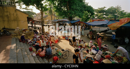 Traditional market street scene in Hoi An in Vietnam in Far East Southeast Asia. People Reportage Photojournalism - Stock Photo