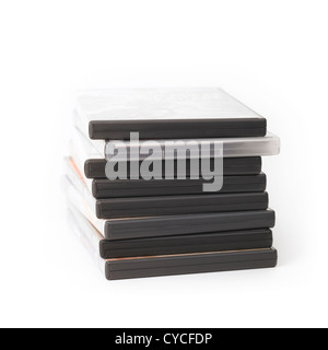 Stack of film dvds in cases on white background - Stock Photo