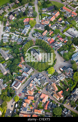 The Netherlands, Raerd, Aerial. Center of village with church on mount. - Stock Photo