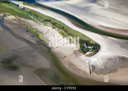 Island called Rottumerplaat. Part of the Wadden Sea islands. UNESCO World Heritage Site. Marsh land, mud flats. - Stock Photo