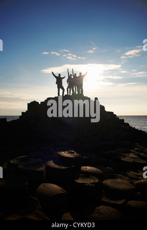 Silhouette of people on Giant's Causeway - Stock Photo