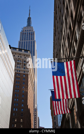 The Empire State Building and American Flags, New York City - Stock Photo
