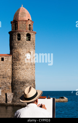 An artist painting the bell tower of Notre-Dame-des-Anges church in Collioure, France. - Stock Photo