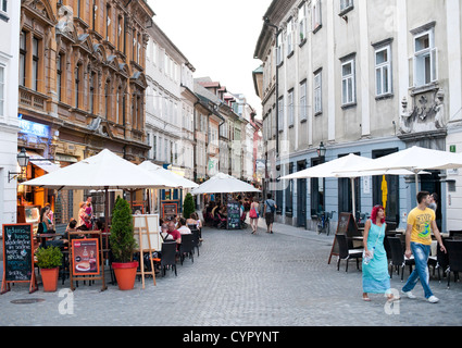 Sidewalk cafes in the old town in Ljubljana, the capital of Slovenia. - Stock Photo