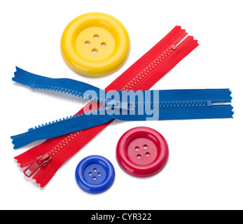 Three colored sewing buttons and two zippers. Isolated on white - Stock Photo