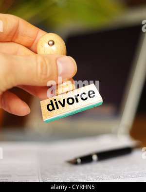 divorce concept with stamp and copyspace in office - Stock Photo