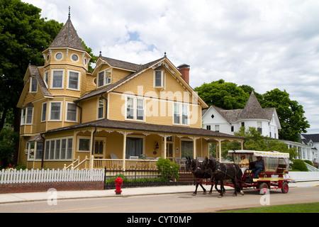 Historic home on Mackinac Island located in Lake Huron, Michigan, USA. - Stock Photo