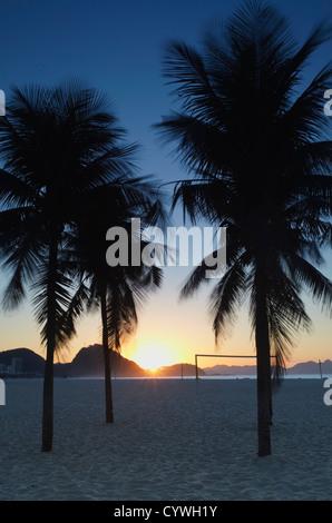 Sunrise on Copacabana beach, Rio de Janeiro, Brazil - Stock Photo