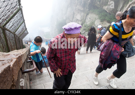 An old lady climbing the Stairway to Heaven, Tai Shan, China - Stock Photo