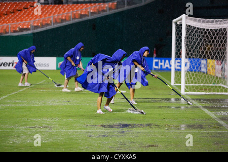 Groundskeepers clears water off the pitch after a heavy storm caused a rain delay of an MLS match between DC United - Stock Photo