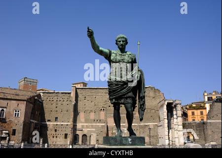 italy, rome, statue of roman emperor julius caesar augustus and forum - Stock Photo