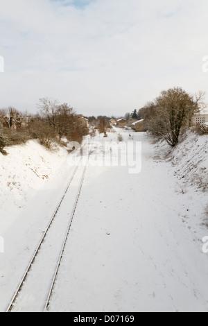 Railway tracks through winter countryside, France, Europe. - Stock Photo